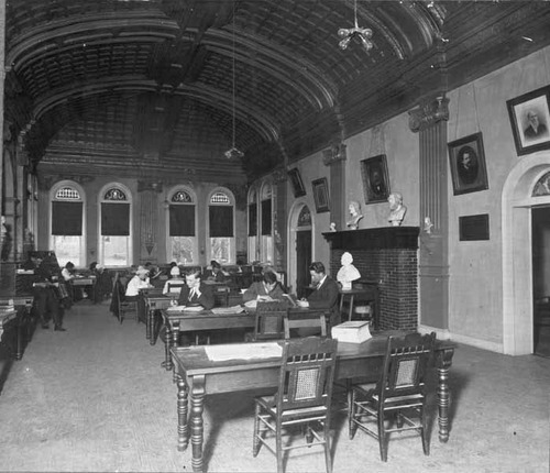 A group of students studying in the Peabody Library in 1915.