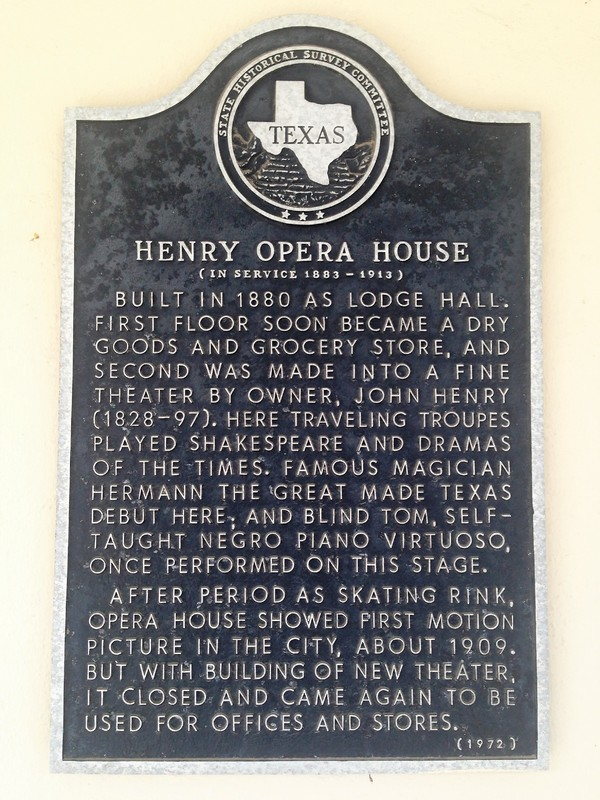 The official Henry Opera House historical marker.