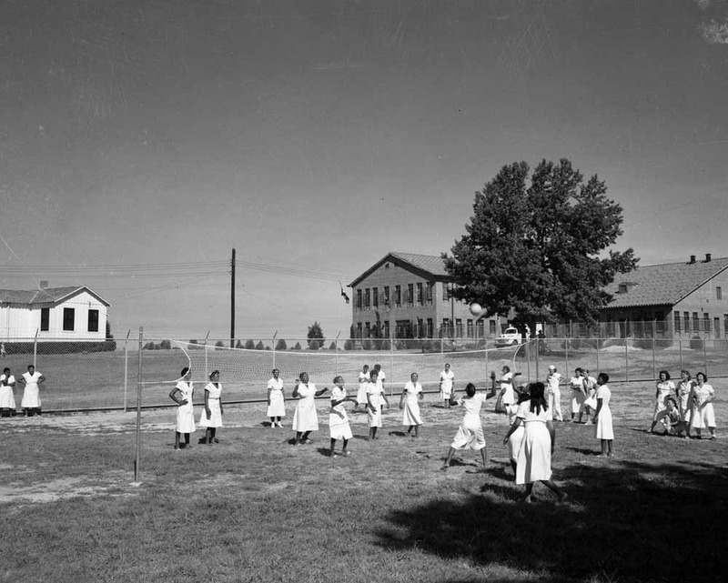 Female inmates playing volleyball at the Goree Unit, circa 1950