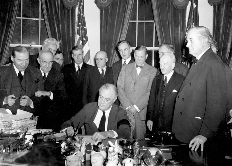 Franklin Roosevelt signs the declaration of war against Japan after the Pearl Harbor attack on December 7, 1941